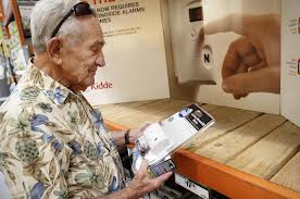 Elderly man buying a CO detector